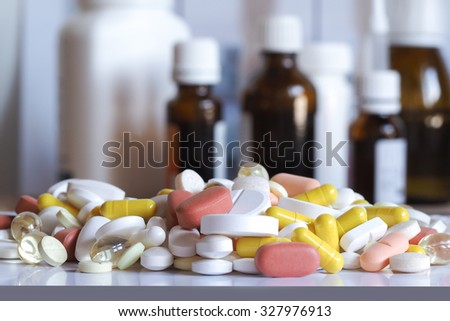Colorful pills on a background of bubbles. Pills, vitamins - stock photo