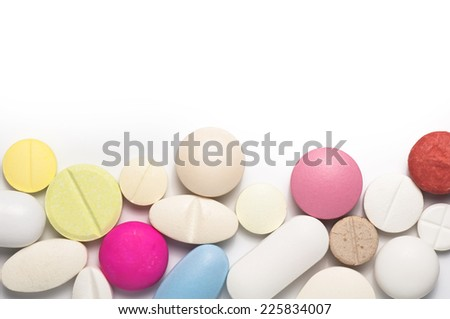 Colorful pills with copy space , white background - stock photo