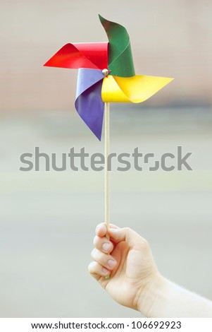 Colorful pinwheel in hand - stock photo