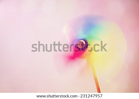 Colorful pinwheel. Instagram effect. Motion blur. - stock photo