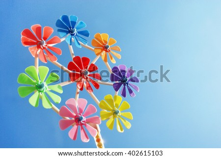 Colorful Pinwheels toy in summer - stock photo