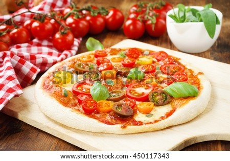 Colorful Pizza Margherita/ Fresh homemade Pizza Margherita with colorful tomatoes, mozzarella and herbs - stock photo