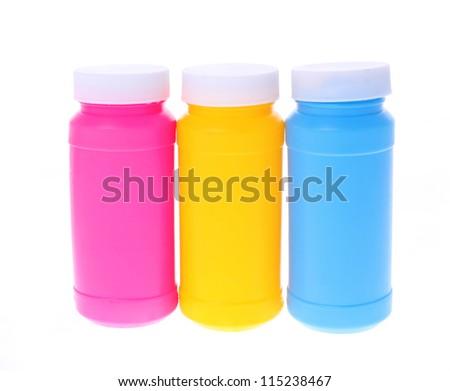 colorful plastic bottles isolated on white - stock photo