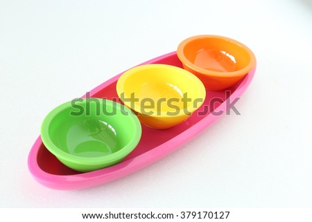 Colorful plastic bowl and round dish. - stock photo