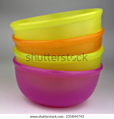 Colorful plastic bowls, stacked and ready for use. - stock photo