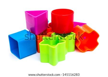 Colorful plastic geometric blocks on white background - stock photo