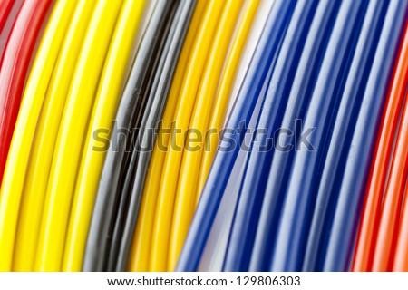 Colorful plastic masterbatch tubes - stock photo
