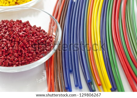 Colorful plastic masterbatch tubes made out of plastic granules - stock photo