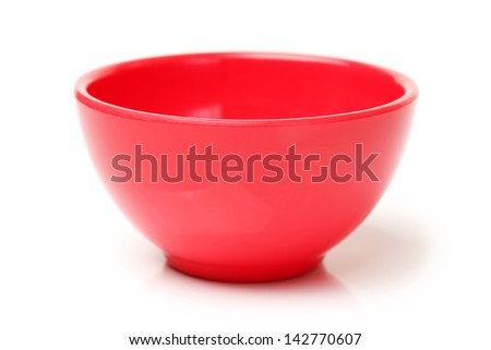 Colorful plastic tableware on white background - stock photo
