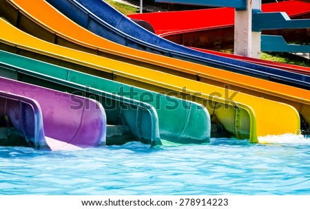 colorful plastic water-slide in swimming pool/ water slide in the aqua park / water slide in the aqua park . close up (water slide, water poor, swimming) - stock photo