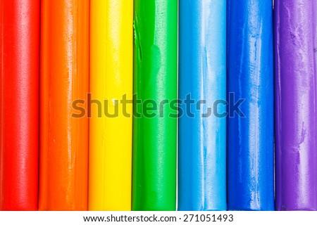 colorful plasticine arrange to rainbow - stock photo