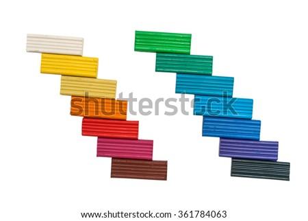 Colorful plasticine isolated on white background - stock photo
