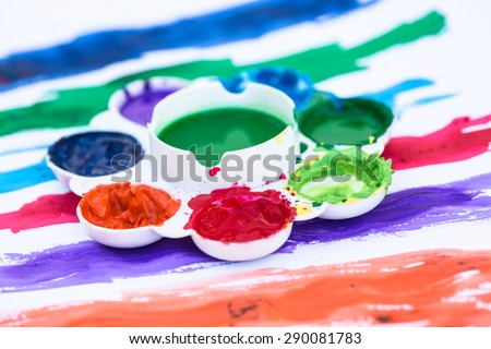 Colorful plate on watercolor painting paper  - stock photo