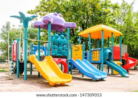 Colorful playground equipment on the playground - stock photo
