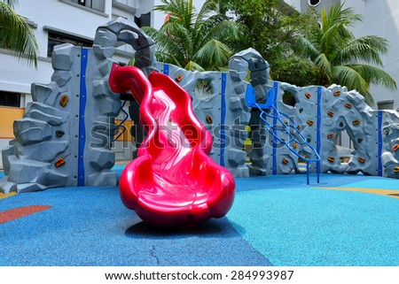 Colorful playground for children in public housing block.  - stock photo