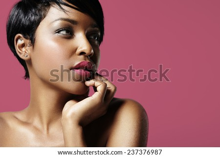 colorful portrait of a pretty black woman with  pink lips - stock photo