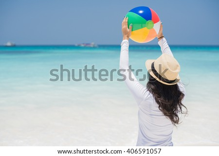 Colorful portrait of beautiful girl on the beach - stock photo