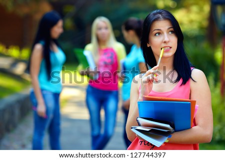 colorful portrait of thoughtful female student - stock photo