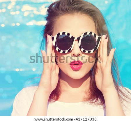 Colorful portrait of young attractive woman wearing sunglasses. Summer beauty  concept - stock photo