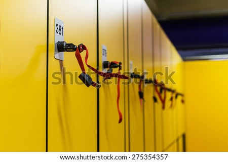 Colorful public lockers with keys in a swimming pool. Property and investment concept. - stock photo