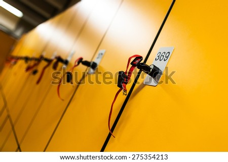 Colorful public lockers with keys in a swimming pool. Security concept. - stock photo