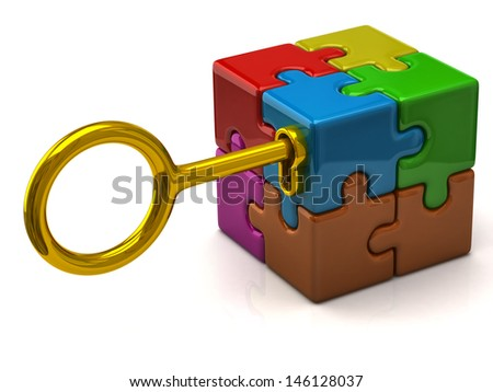 Colorful puzzle cube with golden key. - stock photo
