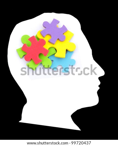 Colorful puzzle in the head - stock photo