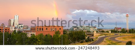 Colorful rainbow in the sky above Denver, Colorado - stock photo
