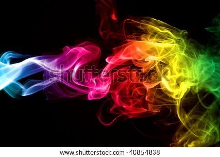 Colorful Rainbow Smoke isolated over black background - stock photo
