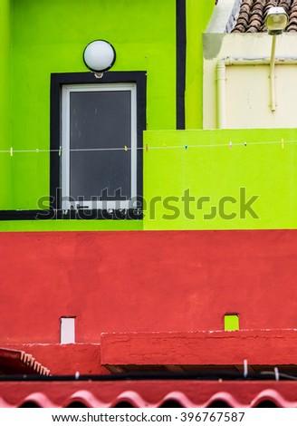 Colorful red and green home facade in Ponta Delgada, Sao Miguel, Azores, Portugal - stock photo