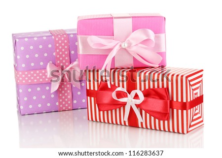 Colorful red, pink and purple gifts isolated on white - stock photo
