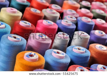 Colorful reels of threads background - A series of TAILOR related images. - stock photo