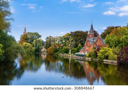 Colorful reflections of trees in the water in Minnerwater park. Bruges, Belgium - stock photo