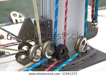 Colorful rigging on a sailboat showing pulleys and ropes - stock photo