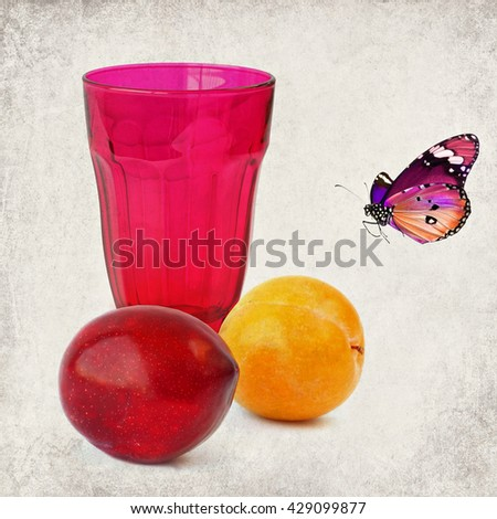 Colorful ripe plums and red drink glass.Still life. Sweet desire. Composition with butterfly. Textured old paper background. Vintage style image - stock photo