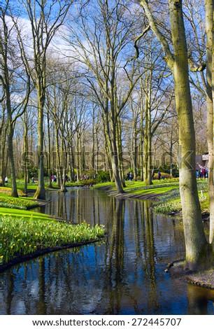Colorful river in dutch garden 'Keukenhof', Holland - stock photo