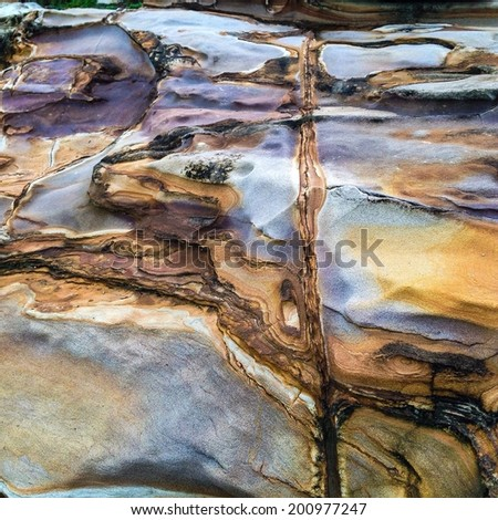 Colorful rock formation on the cliff  - stock photo