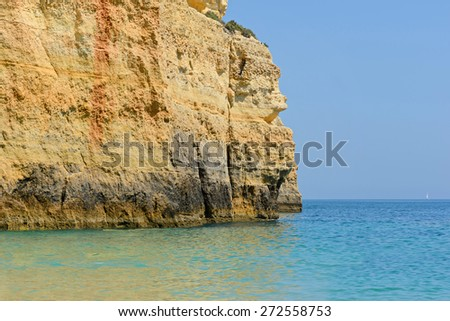 Colorful rocks in the Algarve beach, Portugal - stock photo