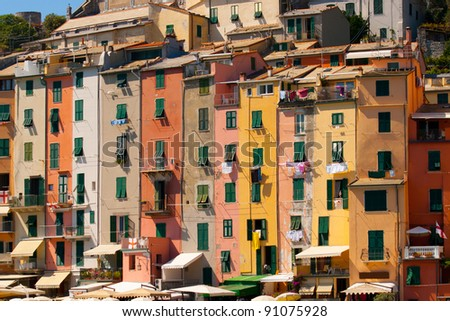 Colorful row houses and hanging laundry in the fishing village of Portovenere, on Italy's west coast. - stock photo