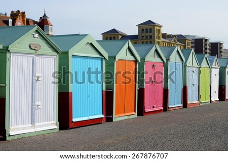 Colorful row of bathing boxes on the quay of Brighton Beach, England, UK.  - stock photo