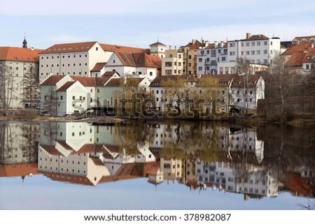 Colorful royal medieval Town Pisek above the river Otava, Czech Republic  - stock photo