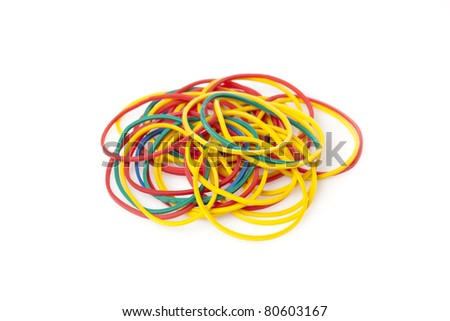 Colorful rubber bands against a white background - stock photo