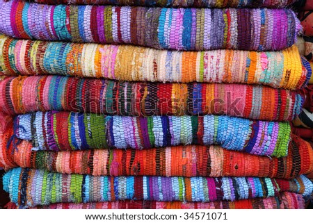 Colorful rugs in the market in jaffa - stock photo