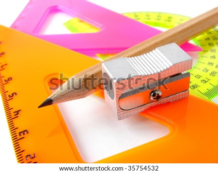colorful rulers set and pencil with sharpener - stock photo