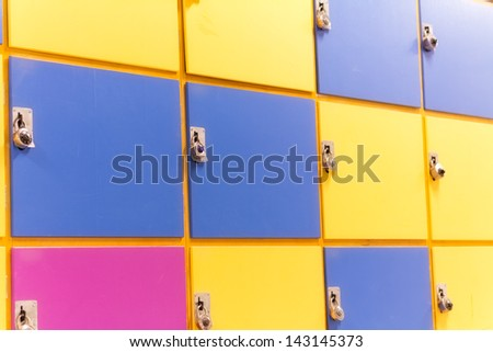 Colorful school lockers in yellow, blue and purple - stock photo