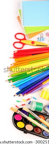 Colorful school stationery isolated on white - stock photo