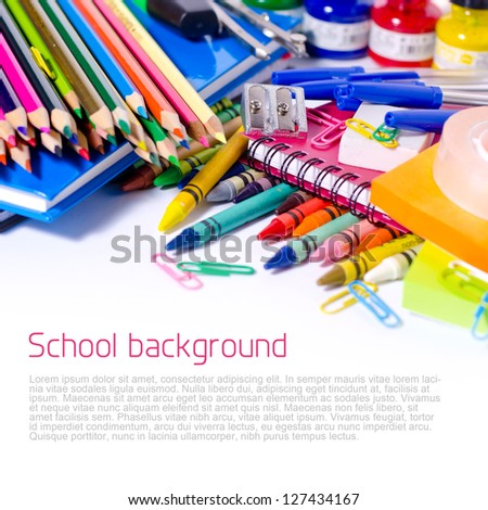 Colorful school supplies - background with copyspace - stock photo