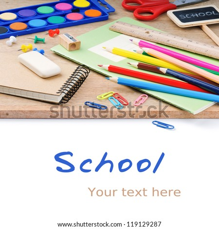 Colorful school supplies over white background - stock photo