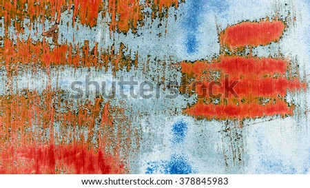 Colorful scratched painted old and abadoned rusty car chassis metal surface as background image - stock photo