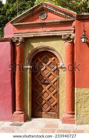 colorful sculpted colonial Spanish door in San Miguel de Allende, Mexico - stock photo
